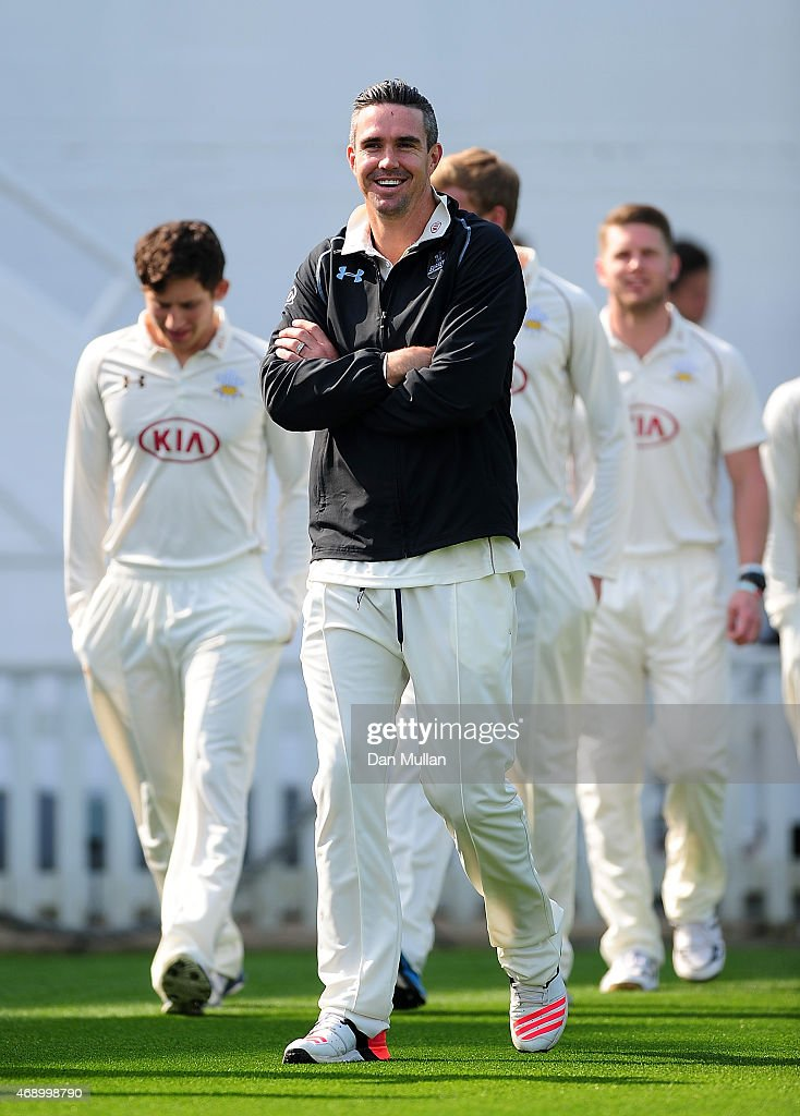 Kevin Pietersen of Surrey makes his way out for the team photo during the Surrey CCC photocall at The Kia Oval on April 09 2015 in London England