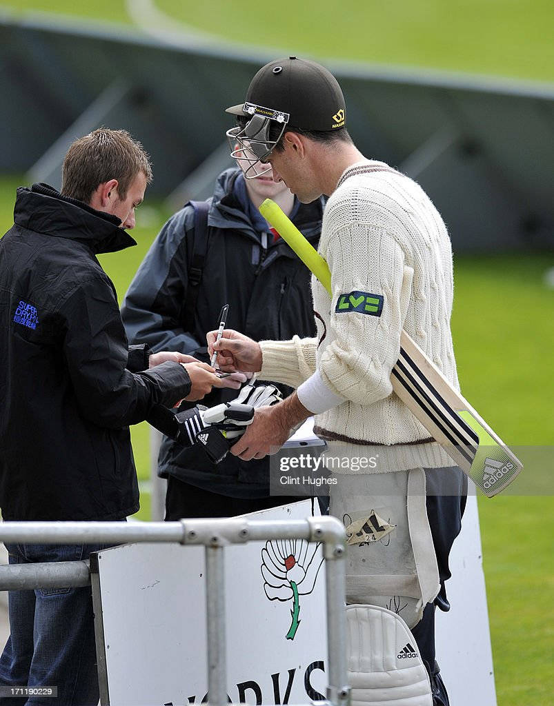 Kevin Pietersen of Surrey signs autographs for fans on his way back to the pavilion after some batting practice during day three of the LV County Championship Division One match between Yorkshire and Surrey at Headingley on June 23, 2013 in Leeds, England.