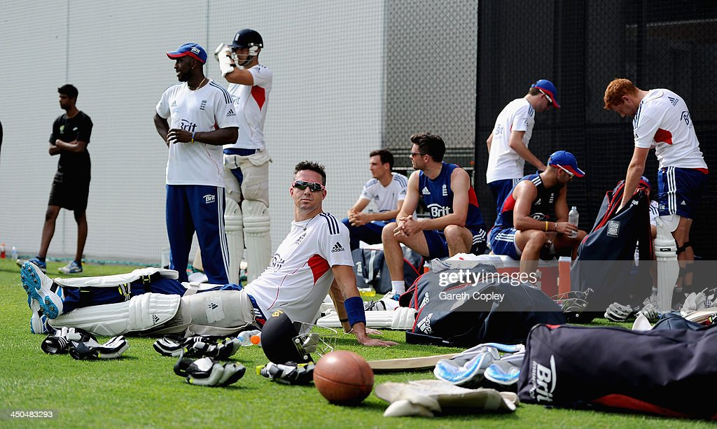 Kevin Pietersen relaxs with teammates after netting during an England nets session at The Gabba on November 19, 2013 in Brisbane, Australia.