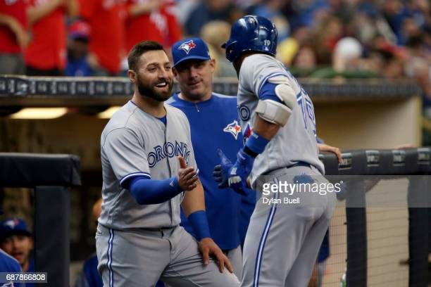 Kevin Pillar and Jose Bautista of the Toronto Blue Jays celebrate after Bautista hit a home run in the fourth inning against the Milwaukee Brewers at...