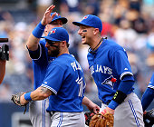 Kevin Pillar and Troy Tulowitzki of the Toronto Blue Jays celebrate with Justin Smoak after the win over the New York Yankees on August 8 2015 at...