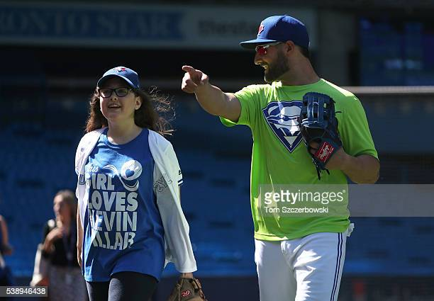 Kevin Pillar of the Toronto Blue Jays after playing catch with fan Ashley from the MakeAWish Foundation before the start of MLB game action against...