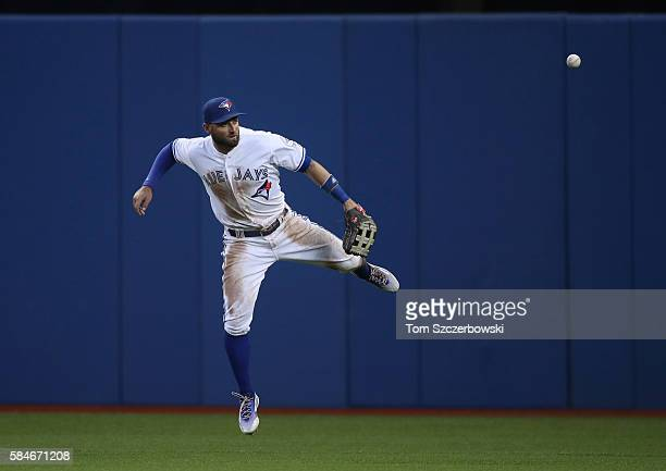 Kevin Pillar of the Toronto Blue Jays blocks a single by Jonathan Schoop of the Baltimore Orioles as the ball skips away from him in the fourth...