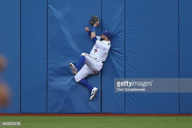 Kevin Pillar of the Toronto Blue Jays catches a fly ball against the wall in the fourth inning during MLBgame action against the Arizona Diamondbacks...
