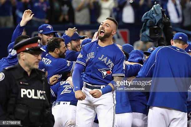 Kevin Pillar of the Toronto Blue Jays celebrates defeating the Baltimore Orioles 52 in the eleventh inning to win the American League Wild Card game...