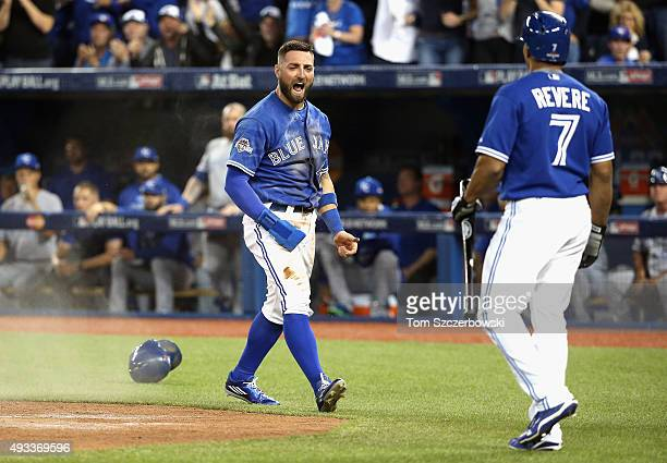 Kevin Pillar of the Toronto Blue Jays celebrates with Ben Revere of the Toronto Blue Jays after scoring a run in the second inning against the Kansas...