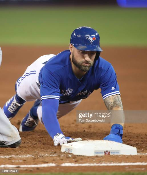 Kevin Pillar of the Toronto Blue Jays dives back to first base safely on a pickoff attempt in the fifth inning during MLB game action against the...
