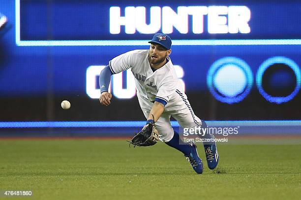 Kevin Pillar of the Toronto Blue Jays dives but cannot come up with the ball that went for a single off the bat of Dee Gordon of the Miami Marlins in...