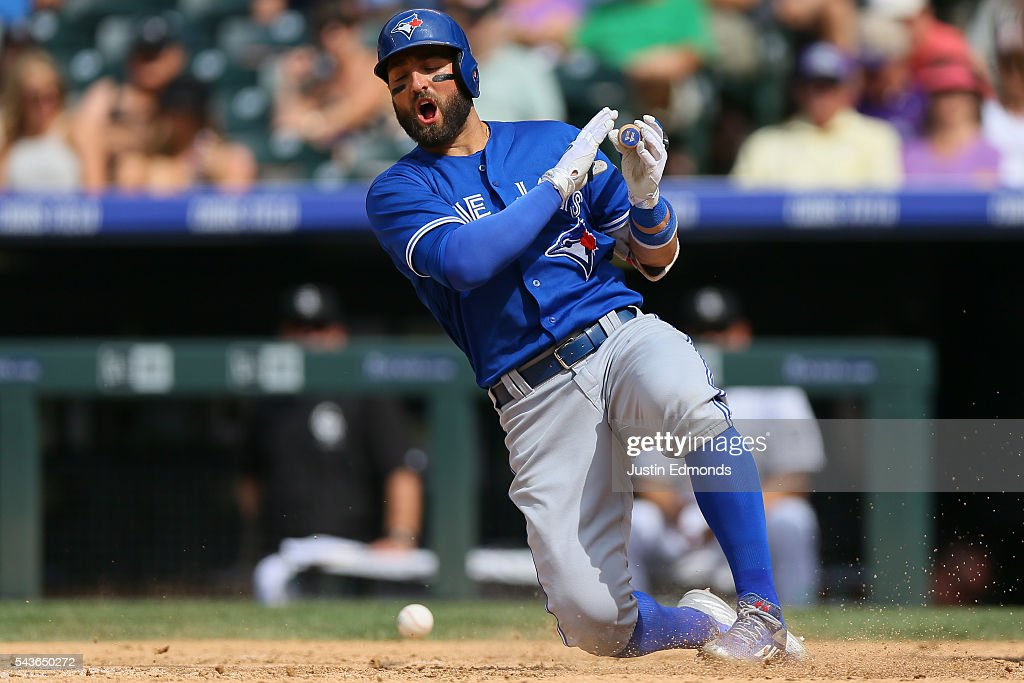 <a gi-track='captionPersonalityLinkClicked' href=/galleries/search?phrase=Kevin+Pillar&family=editorial&specificpeople=11270044 ng-click='$event.stopPropagation()'>Kevin Pillar</a> #11 of the Toronto Blue Jays fouls a ball off of his foot during the ninth inning against the Colorado Rockies at Coors Field on June 29, 2016 in Denver, Colorado. The Blue Jays defeated the Rockies 5-3.