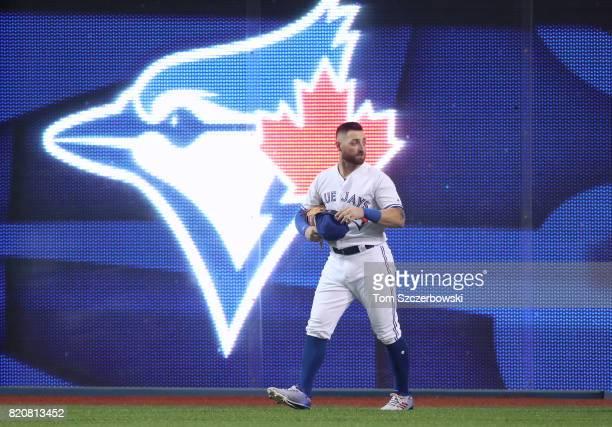 Kevin Pillar of the Toronto Blue Jays gets up after making a running catch and slamming into the wall in the seventh inning during MLB game action...