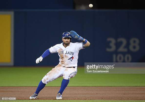 Kevin Pillar of the Toronto Blue Jays is caught in a rundown between first base and second base before being tagged out in the fourth inning during...
