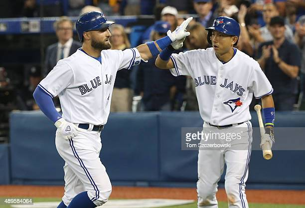 Kevin Pillar of the Toronto Blue Jays is congratulated by Munenori Kawasaki after hitting a solo home run in the third inning during MLB game action...