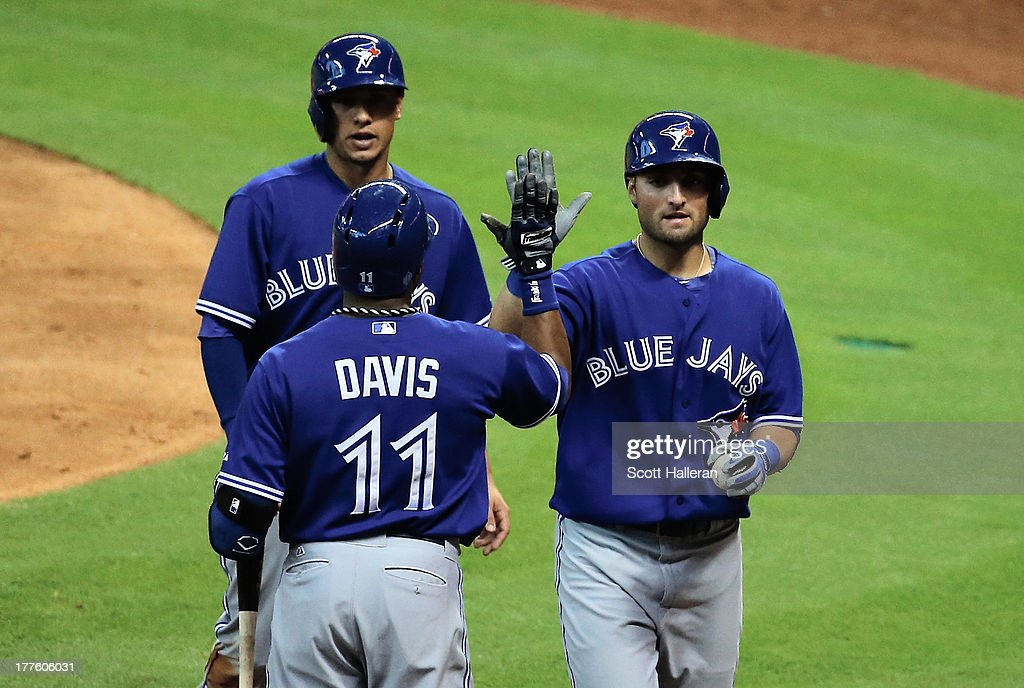 Kevin Pillar #22 of the Toronto Blue Jays is greeted by <a gi-track='captionPersonalityLinkClicked' href=/galleries/search?phrase=Rajai+Davis&family=editorial&specificpeople=810608 ng-click='$event.stopPropagation()'>Rajai Davis</a> #11 after Pillar hits a three run home run in the fifth inning against the Houston Astros at Minute Maid Park on August 24, 2013 in Houston, Texas.