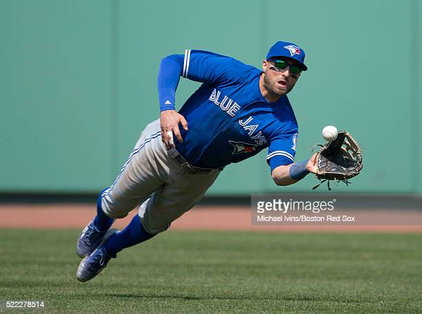 Kevin Pillar of the Toronto Blue Jays makes a diving catch against the Boston Red Sox in the eighth inning on April 18 2016 at Fenway Park in Boston...