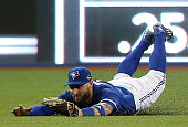 Kevin Pillar of the Toronto Blue Jays makes a diving catch on a ball hit by Josh Hamilton of the Texas Rangers in the fourth inning in game five of...