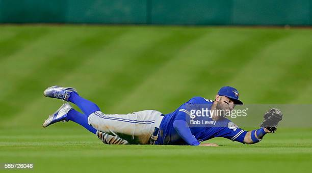 Kevin Pillar of the Toronto Blue Jays makes a diving catch on a line drive by Jose Altuve of the Houston Astros in he fourth inning at Minute Maid...