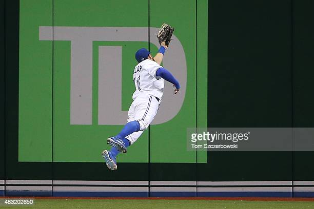 Kevin Pillar of the Toronto Blue Jays makes a leaping catch in the eighth inning during MLB game action against the Minnesota Twins on August 6 2015...