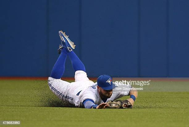 Kevin Pillar of the Toronto Blue Jays makes a sliding catch in the sixth inning during MLB game action against the Texas Rangers on June 26 2015 at...