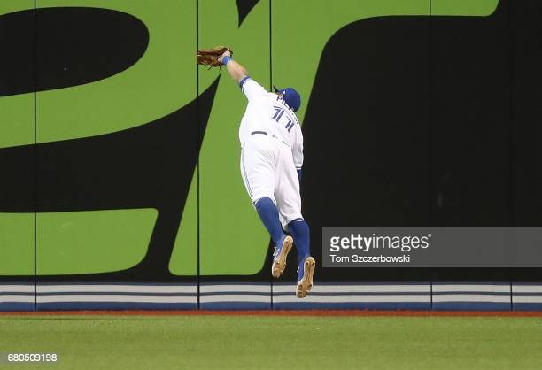 Kevin Pillar of the Toronto Blue Jays makes an inningending diving catch to end the sixth inning during MLB game action against the Cleveland Indians...