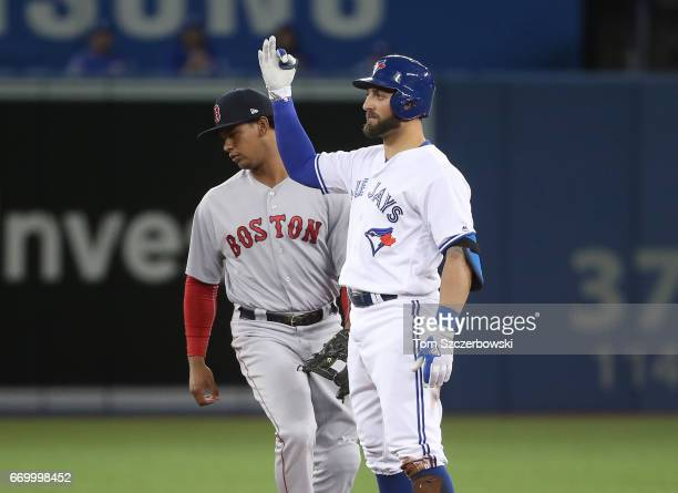 Kevin Pillar of the Toronto Blue Jays reacts after hitting a leadoff double in the first inning during MLB game action against the Boston Red Sox at...