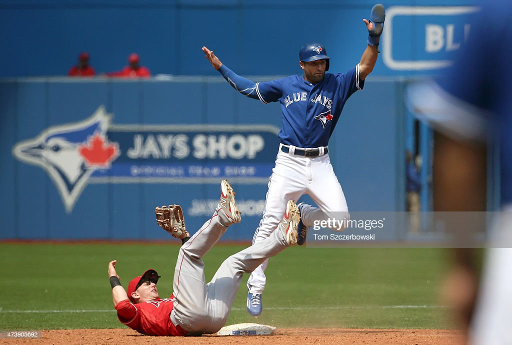 <a gi-track='captionPersonalityLinkClicked' href=/galleries/search?phrase=Kevin+Pillar&family=editorial&specificpeople=11270044 ng-click='$event.stopPropagation()'>Kevin Pillar</a> #11 of the Toronto Blue Jays reacts as he is caught stealing in the fifth inning during MLB game action as <a gi-track='captionPersonalityLinkClicked' href=/galleries/search?phrase=Johnny+Giavotella&family=editorial&specificpeople=7512348 ng-click='$event.stopPropagation()'>Johnny Giavotella</a> #12 of the Los Angeles Angels of Anaheim tags him out on May 18, 2015 at Rogers Centre in Toronto, Ontario, Canada.