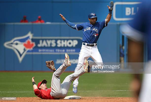 Kevin Pillar of the Toronto Blue Jays reacts as he is caught stealing in the fifth inning during MLB game action as Johnny Giavotella of the Los...