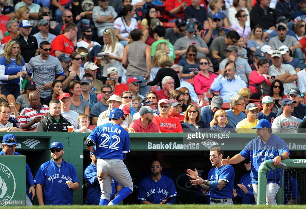 Kevin Pillar #22 of the Toronto Blue Jays receives high fives from teamates after hitting a solo homerun in the fifth inning against the Boston Red Sox at Fenway Park on September 22, 2013 in Boston, Massachusetts.
