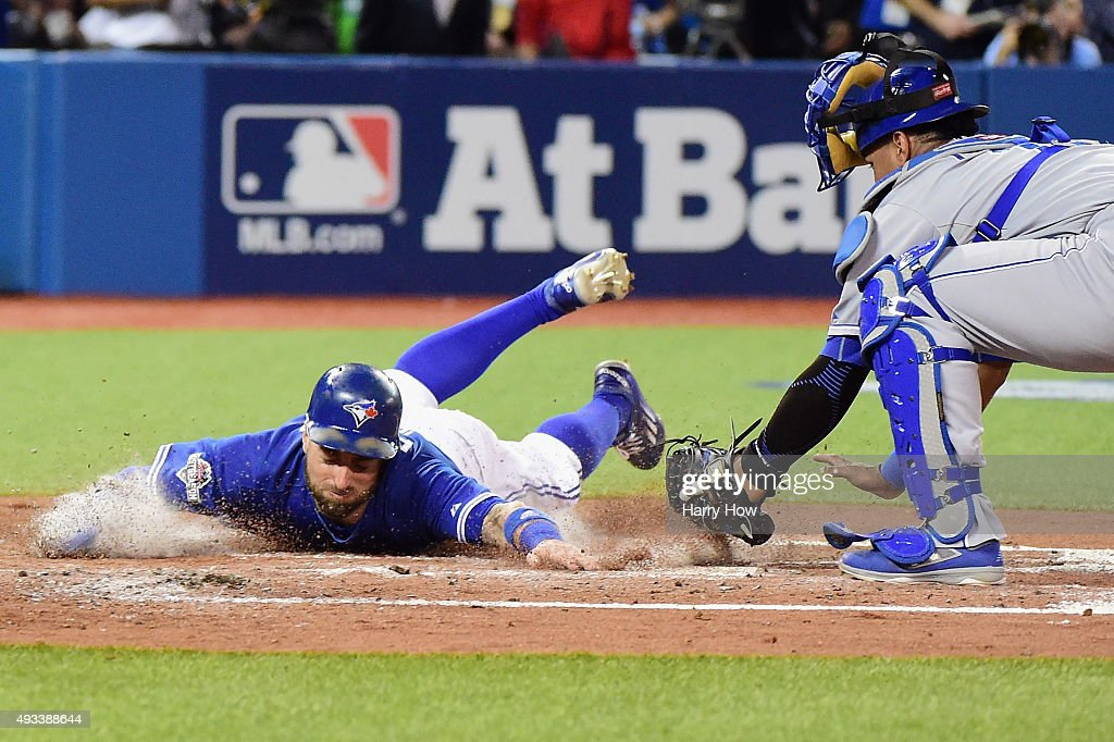 Kevin Pillar #11 of the Toronto Blue Jays scores a run in the second inning against the Kansas City Royals during game three of the American League Championship Series at Rogers Centre on October 19, 2015 in Toronto, Canada.