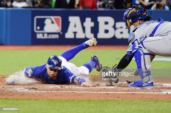 Kevin Pillar of the Toronto Blue Jays scores a run in the second inning against the Kansas City Royals during game three of the American League...