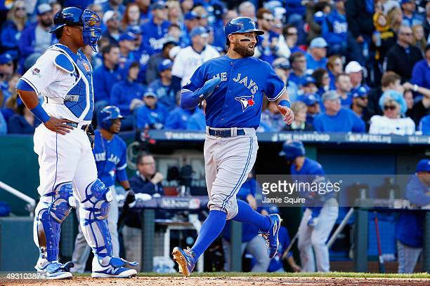 Kevin Pillar of the Toronto Blue Jays scores a run in the third inning against the Kansas City Royals in game two of the American League Championship...