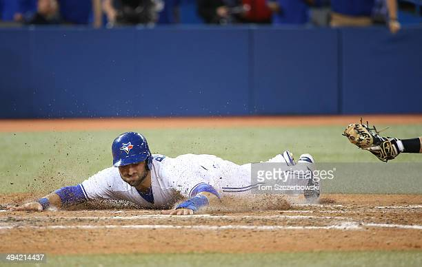 Kevin Pillar of the Toronto Blue Jays slides across home plate to score the winning run in the ninth inning during MLB game action against the Tampa...