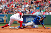 Kevin Pillar of the Toronto Blue Jays steals second base as Dustin Pedroia of the Boston Red Sox applies the tag during the third inning of the game...
