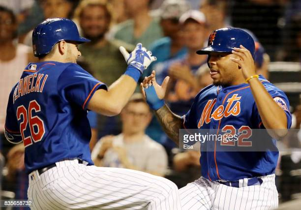 Kevin Plawecki of the New York Mets and Dominic Smith celebrate after Pawlecki drove them both home in the sixth inning against the Miami Marlins on...