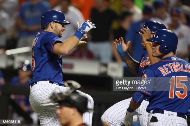 Kevin Plawecki of the New York Mets celebrates his two run home run in the sixth inning with Dominic Smith of the New York Mets and Matt Reynolds of...