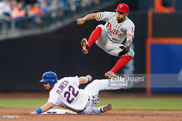 Kevin Plawecki of the New York Mets is forced out at second base as Freddy Galvis of the Philadelphia Phillies is unable to complete the double play...