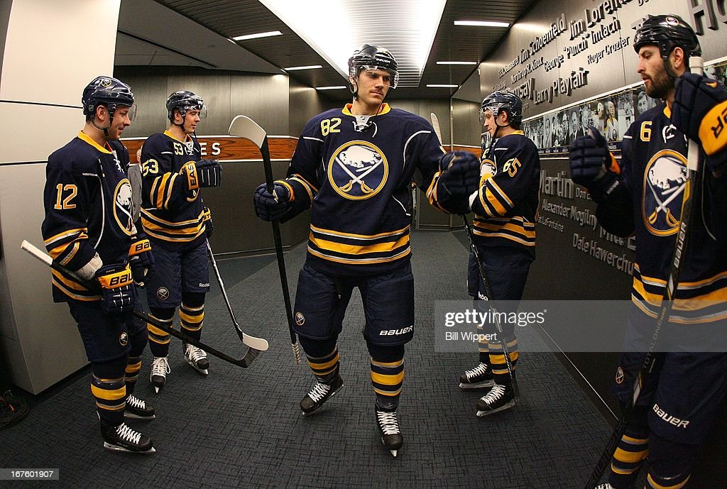 Kevin Porter #12, Marcus Foligno #82 and Mike Weber #6 of the Buffalo Sabres get ready to take the ice against the New York Islanders on April 26, 2013 at the First Niagara Center in Buffalo, New York.