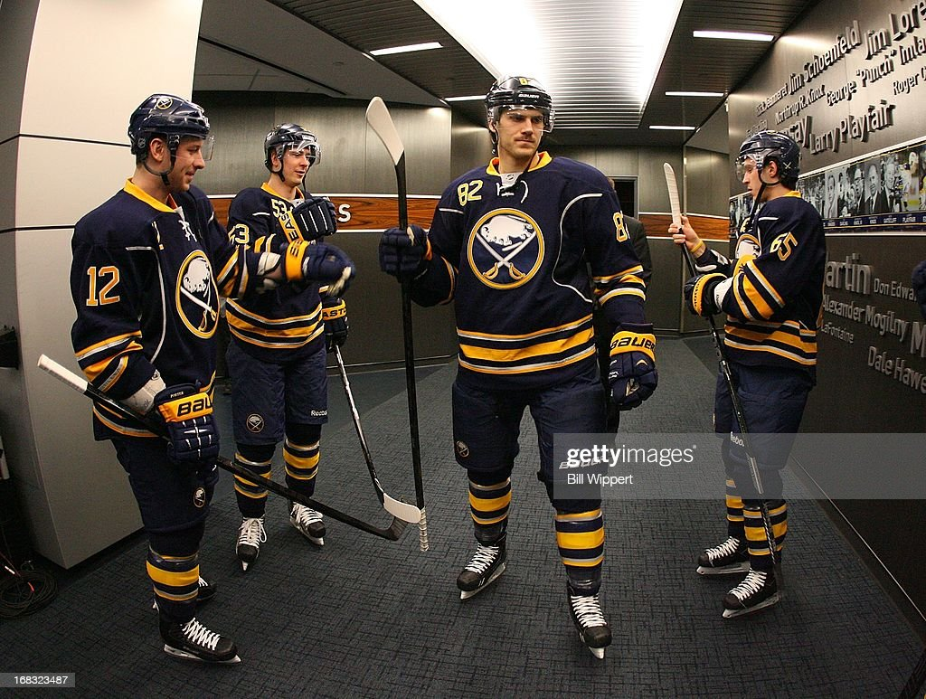 Kevin Porter #12, Mark Pysyk #53, Marcus Foligno #82 and Brian Flynn #65 of the Buffalo Sabres prepare to play the New York Islanders on April 26, 2013 at the First Niagara Center in Buffalo, New York.