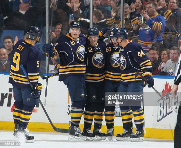 Kevin Porter of the Buffalo Sabres celebrates his goal against the Tampa Bay Lightning with teammates Steve Ott Christian Ehrhoff Brian Flynn and...