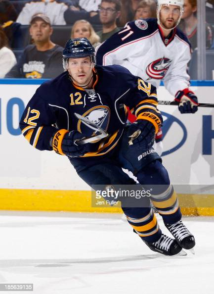 Kevin Porter of the Buffalo Sabres skates against the Columbus Blue Jackets at First Niagara Center on October 10 2013 in Buffalo New York