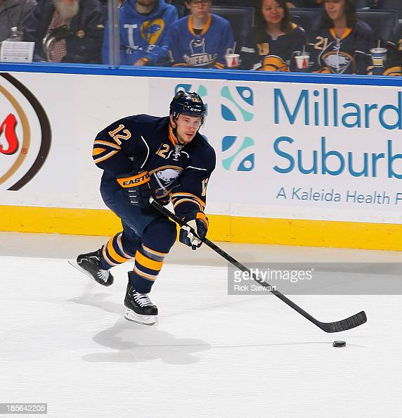 Kevin Porter of the Buffalo Sabres skates against the Minnesota Wild at First Niagara Center on October 14 2013 in Buffalo New York Minnesota won 21