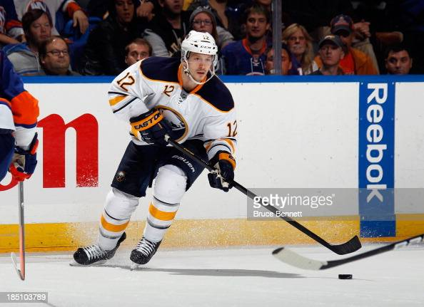 Kevin Porter of the Buffalo Sabres skates against the New York Islanders at the Nassau Veterans Memorial Coliseum on October 15 2013 in Uniondale New...