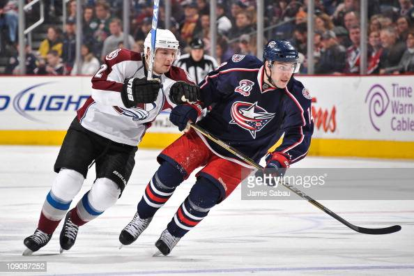 Kevin Porter of the Colorado Avalanche and Grant Clitsome of the Columbus Blue Jackets skate after a loose puck on February 11 2011 at Nationwide...