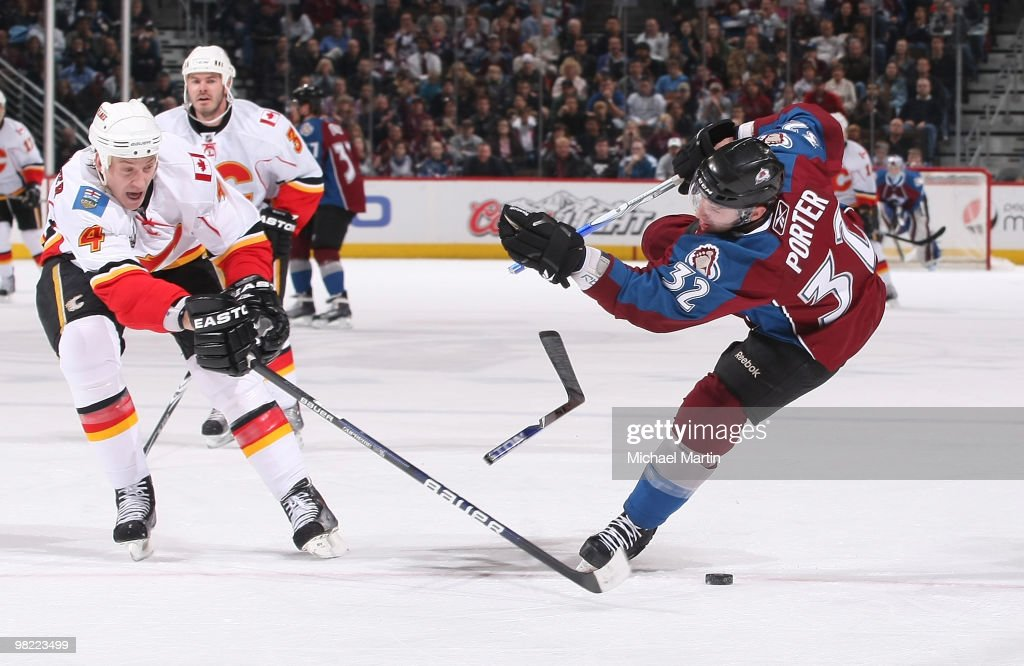 Kevin Porter of the Colorado Avalanche breaks his stick while shooting against Jay Bouwmeester ofthe Calgary Flames at the Pepsi Center on April 2...