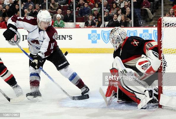 Kevin Porter of the Colorado Avalanche follows the puck toward goalie Corey Crawford of the Chicago Blackhawks on January 12 2011 at the United...
