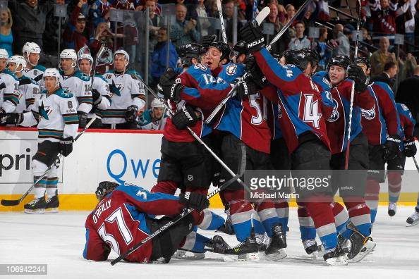 Kevin Porter of the Colorado Avalanche is mobbed by teammates after scoring the gamewinning goal in overtime against the San Jose Sharks for a 43 win...