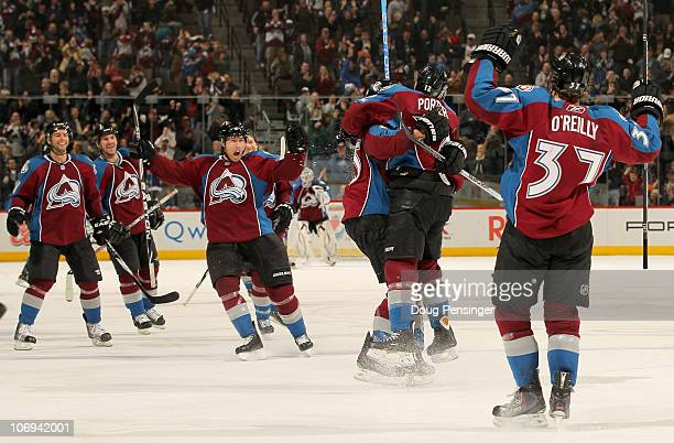 Kevin Porter of the Colorado Avalanche jumps into the arms of Chris Stewart as he celebrates his game winning goal in overtime against the San Jose...