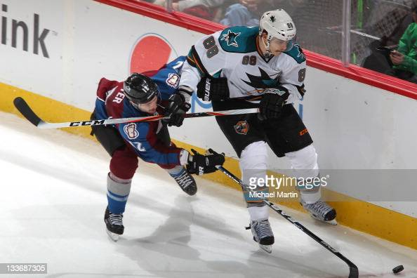Kevin Porter of the Colorado Avalanche skates against Brent Burns of the San Jose Sharks at the Pepsi Center on November 20 2011 in Denver Colorado