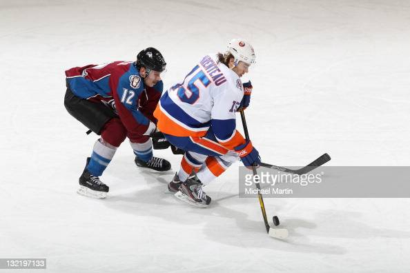 Kevin Porter of the Colorado Avalanche skates against PA Parenteau of the New York Islanders at the Pepsi Center on November 10 2011 in Denver...