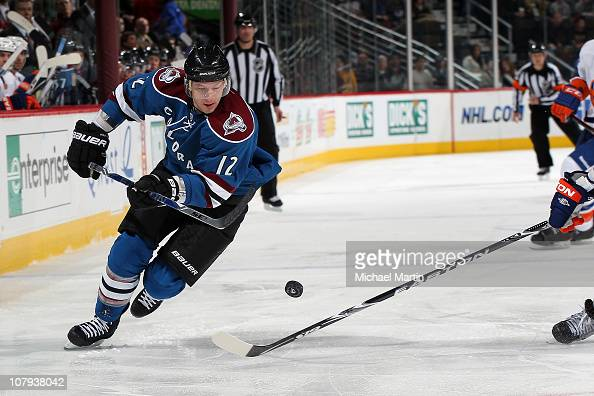 Kevin Porter of the Colorado Avalanche skates the bouncing puck against the New York Islanders at the Pepsi Center on January 8 2011 in Denver...