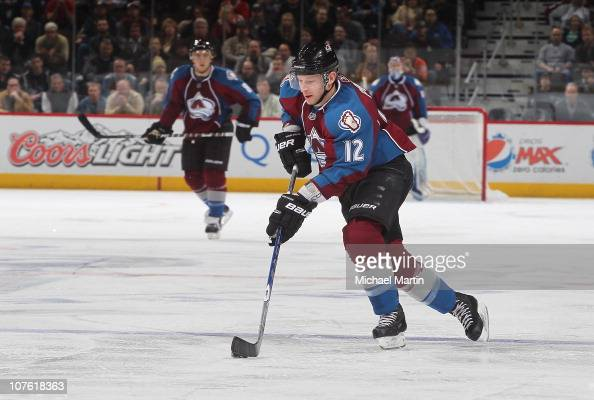 Kevin Porter of the Colorado Avalanche skates with the puck against the Chicago Blackhawks during the game at the Pepsi Center on December 13 2010 in...